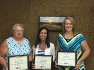 Rhonda McFadden,  Heather Peek and Alison Baldwin displaying their Team Awards