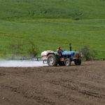 Farmer riding a tractor