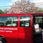 Red van with bucket garden kits