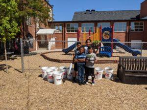 kids with bucket garden kits