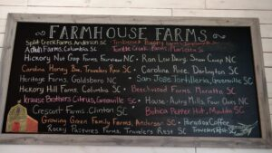 chalkboard with locally sourced ingredients at a restaurant