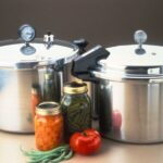 picture of pressure canners with jars of greenbeans and carrots